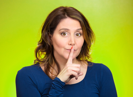 Female showing hand silence sign